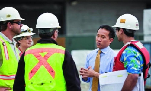 David Chiu, running for the State Assembly, consults with members of the building trades.